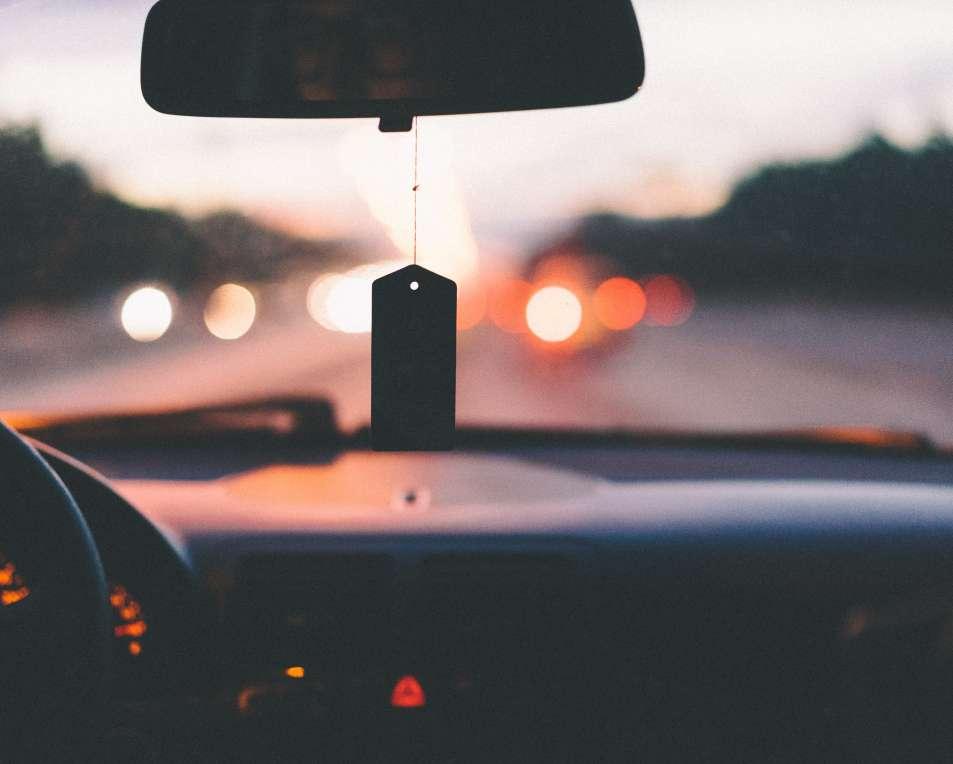Car interior in sunset